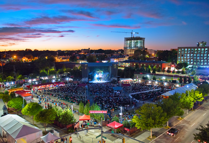 An Elevated View Of Red Hat Amphitheater During A Colorful Sunset