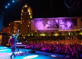 Live performers on stage at Red Hat Amphitheater at night
