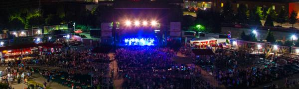 An elevated view of the crowd at Red Hat Amphitheater during a nighttime concert